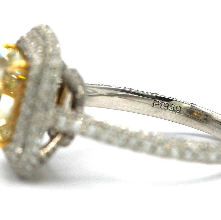 4.25 Carat EGL Fancy Light Yellow Cushion SI1 Diamond with Pave Platinum Ring In New Condition For Sale In New York, NY