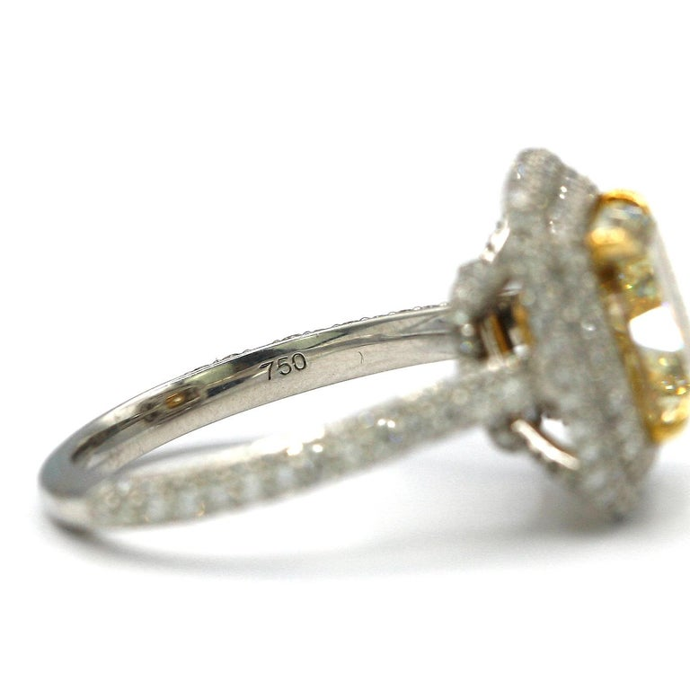 Women's or Men's 4.25 Carat EGL Fancy Light Yellow Cushion SI1 Diamond with Pave Platinum Ring For Sale