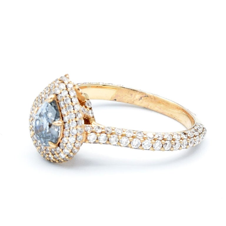 This remarkable natural 0.58 Carat Pear shape Fancy grayish blue is certified from GIA (report #1162731992).  Set in 18 karat rose gold and surrounded in pavé diamonds.  Ring Size 6 (resizeable) 3.70 grams   Every Upper-Luxury piece will arrive in
