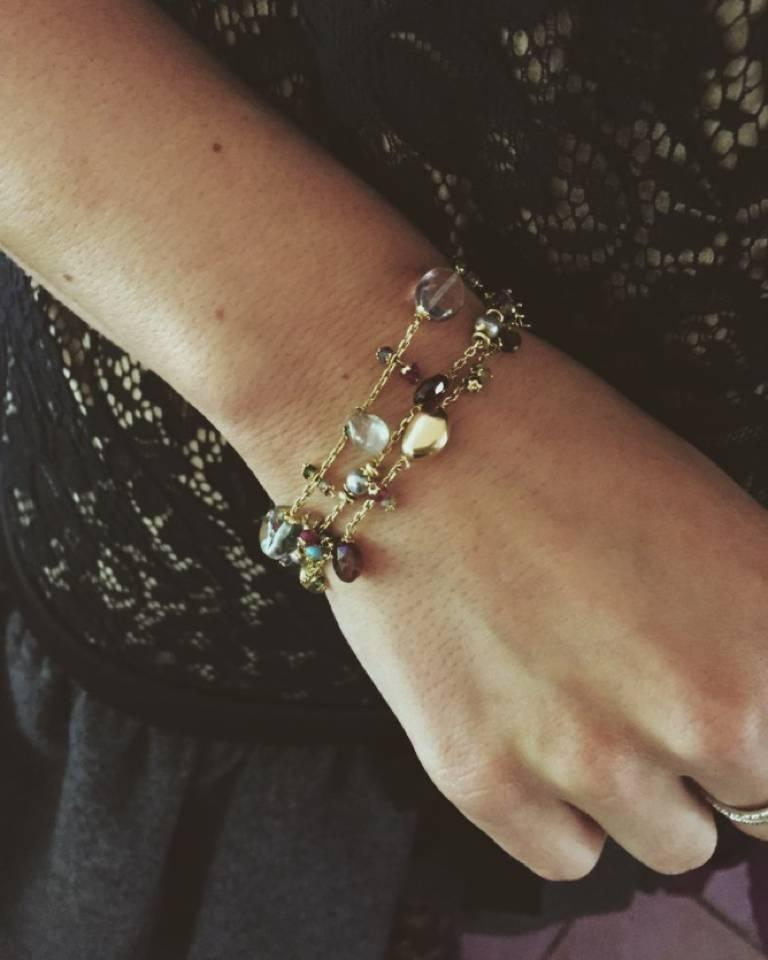 Handmade in our 150 year old Italian workshop, this pretty bracelet is adorned with White Pearls, Peridot, Garnet and Spinels. Set in 18 karat gold this charm bracelet is finished with a gold drop on the clasp.  Each bracelet is one of a kind so no