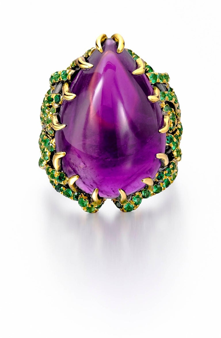 18K yellow gold, satin finish. Custom-cut 27.64 carat amethyst. 118 tsavorites, totaling 2 carats. Made in New York City. Size 6. To request additional photos or videos, please contact us.  This gorgeous ring was created in New York City by our