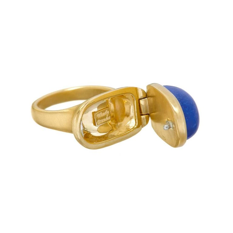 Locket ring opens and closes to reveal a hidden compartment. 18K yellow gold, satin finish. Custom-cut lapis lazuli. Size 6. One-of-a-kind. Made in New York City. Visit our storefront to see a video of this piece in action!  Wendy Brandes Gold