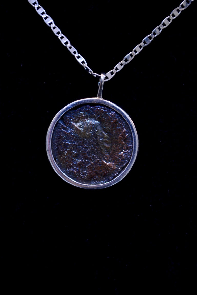 Authentic Roman bronze coin Ca. 27 BC - 476 AD mounted on contemporary silver necklace. Ready to be worn!  Bronze coin from the great Roman Empire that dates back nearly 2,000 years. Beautiful iridescence.
