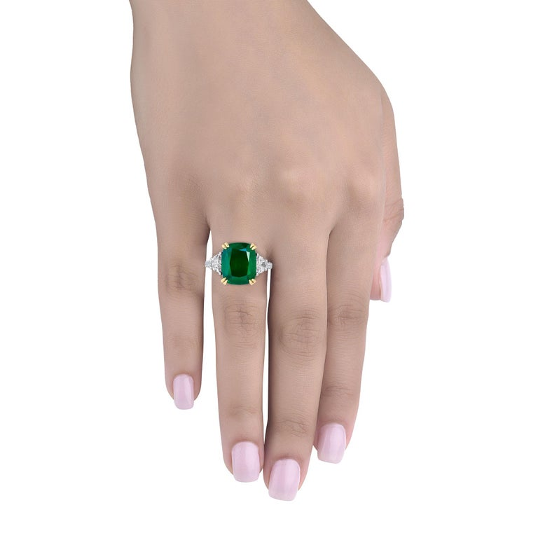 Hand made in the Emilio Jewelry Factory, A gorgeous certified deep green Cushion Zambian Emerald 6.02 Carats set in the center. The emerald is fairly clean and completely eye clean.  Center Emerald Dimensions: 12.35x10.26mm The diamonds total .83and