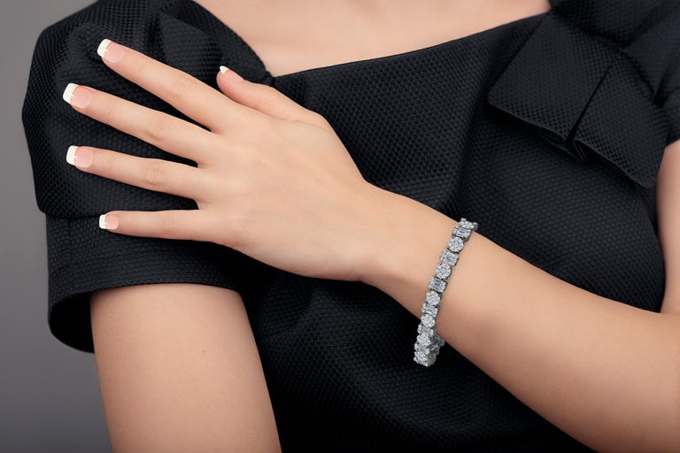 This striking diamond bracelet gives the impression of a much larger piece!  Color: E-F Clarity: Vs2  Metal: !8kw Length: 7 inches can be shorter or long by request  For your piece of mind we are a proud Top Selling dealer on 1stdibs with 5 Star