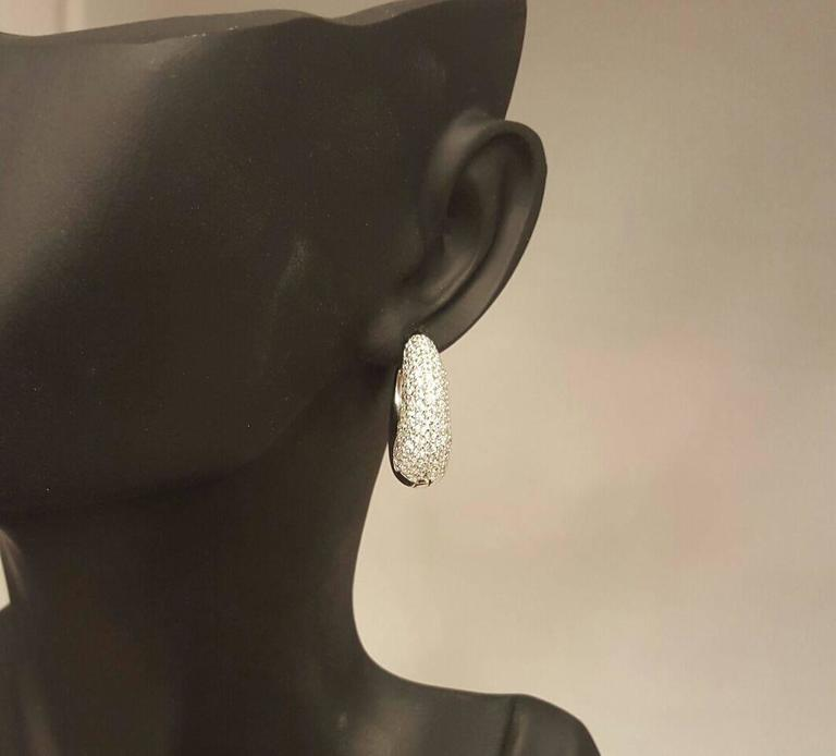 246 round excellent cut white diamonds micro pave hand set totaling 2.71ct t.w. using F color vs1 clarity diamonds. This earring can be ordered in 14k/18k white/yellow/rose/black gold. We also added a push lock mechanism to ensure the earring does