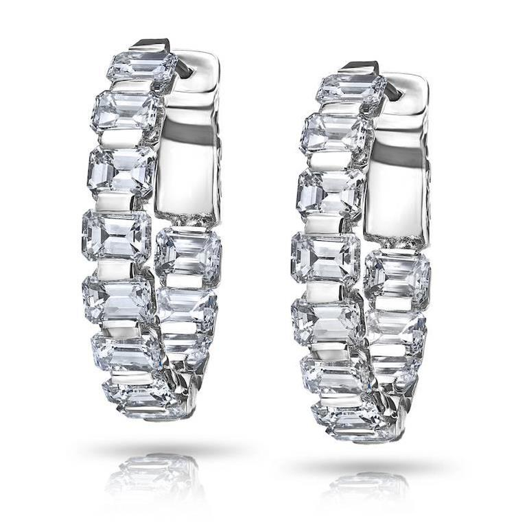 22 Excellent cut Emerald cut diamonds set in this one of a kind 18k white gold hoop earring.  Color: F-G  Clarity: VVS  Cut: Excellent