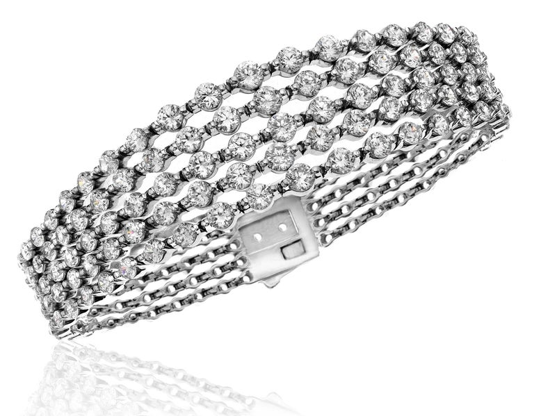 This bracelet features our one of a kind endless push lock mechanism with Graduating diamonds up to .25ct each!  The whole bracelet is encrusted with natural diamonds including the lock! 5 rows of diamonds!  Can be shortened or lengthened because we