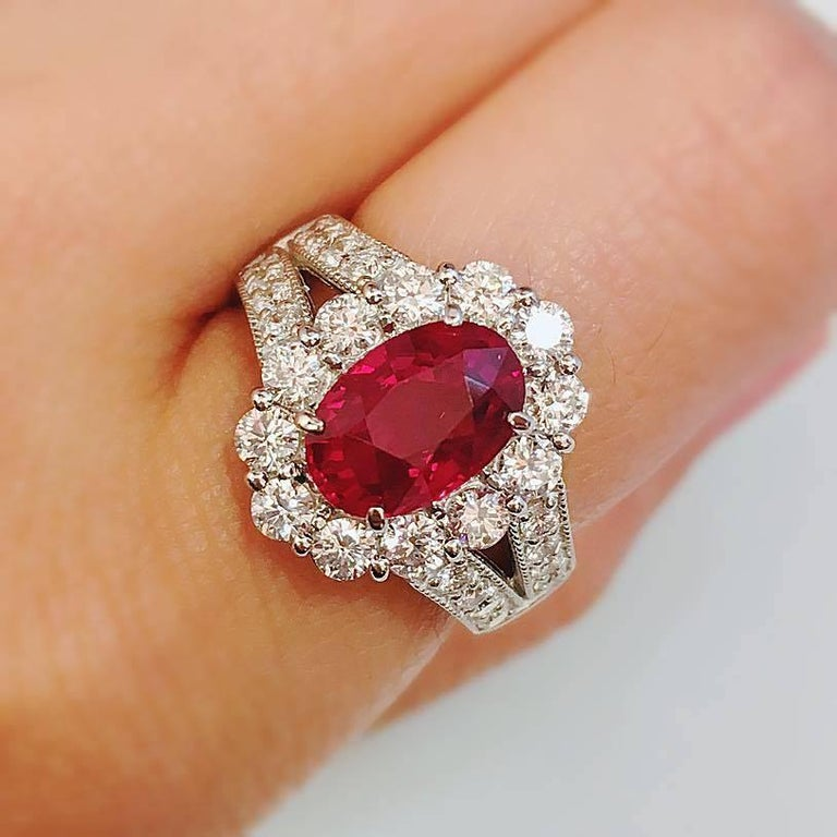 Pigeons blood vivid red Burmese Ruby an extremely rare piece!  Center Ruby: 3.12 Carats clean Gem quality full of life and fire!   Diamond Color: E  Clarity: Vvs1  Cut: Excellent    Approx tw 4.42ct All Emilio! pieces come with a professional