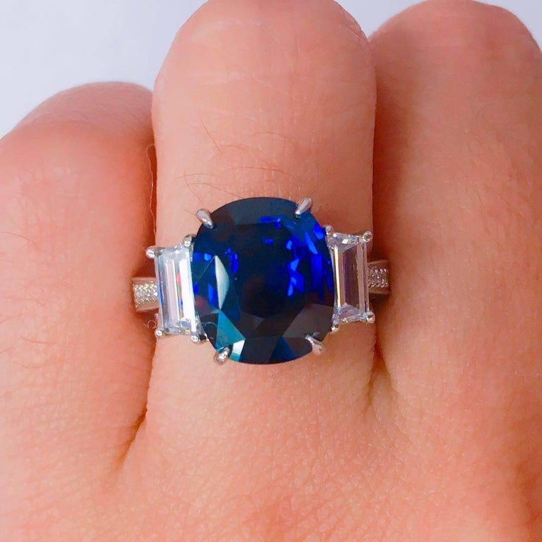 Set in Platinum this ring is sure to make any cloudy day a sunny one with Blue skies! Gorgeous center sapphire is full of life, has a gorgeous deep royal blue color to it, and the diamonds are all E color Vvs1 clarity.  We will size this ring at no