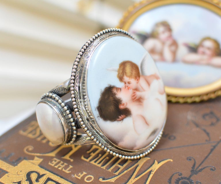 Oval Cut Jill Garber Rare French Cupids Kiss Porcelain with Mother-of-Pearl Cuff Bracelet For Sale