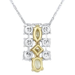 1.13 Carat Natural Fancy Yellow Diamond and 0.27 Carat White Diamond Pendant