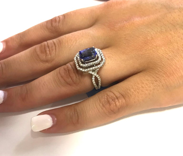 1.99 Carat Emerald Cut Tanzanite and 0.65 Carat White Diamond Ring In New Condition For Sale In GREAT NECK, NY