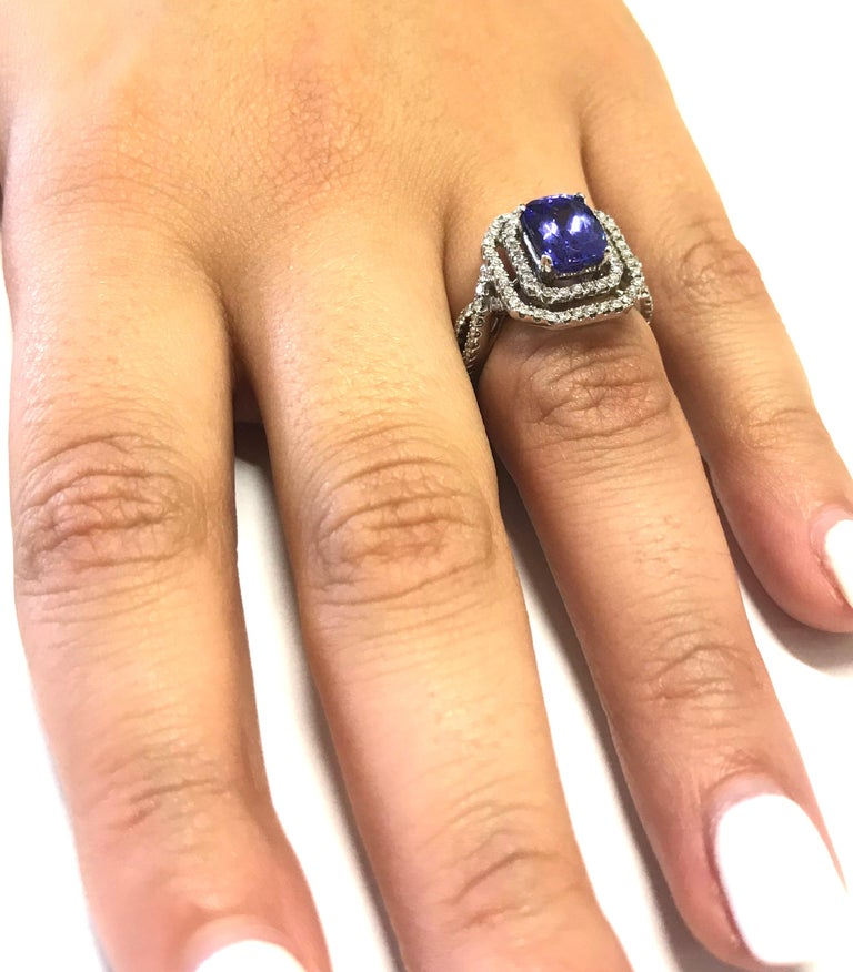 Women's 1.99 Carat Emerald Cut Tanzanite and 0.65 Carat White Diamond Ring For Sale