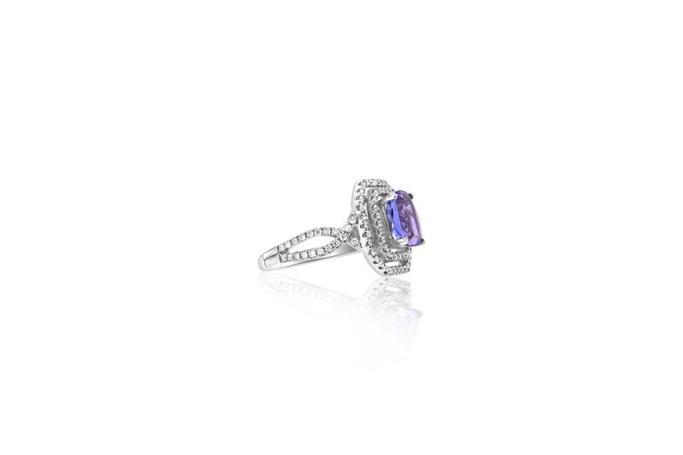 A truly stunning piece, this 1.99 Carat Emerald Cut Tanzanite shines against its 18K White Gold setting encased with brilliant white diamonds. A piece to treasure for years to come!   Material: 18k White Gold  Center Stone Details: 1.99 Carat