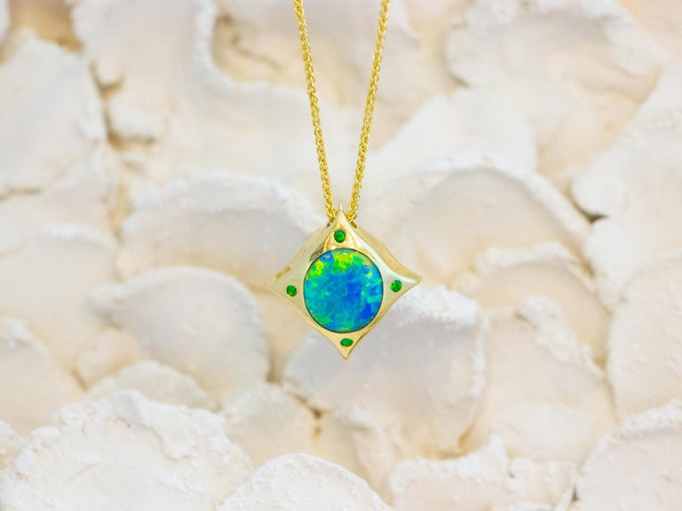 Compass Pendant. Wear this pendant everyday as a talisman. Mine to market solid 2.57 carat Australian Lightening Ridge opal set in hand fabricated 18 karat recycled gold bezel with tsavorites at the points.  Dimensions: 1.9 cm x 1.8 cm x 0.6 cm