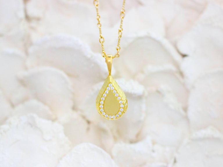 Reversible drop necklace with Sheahan Stephan Ceylon Sapphires on one side, and FG-VS Canadian diamonds on the other. $5,940.  Dimensions: 2.2 cm from top of bail to bottom of drop x 1.1 cm in width x 0.4 cm in depth. 3.5 grams.  Hand carved wax is