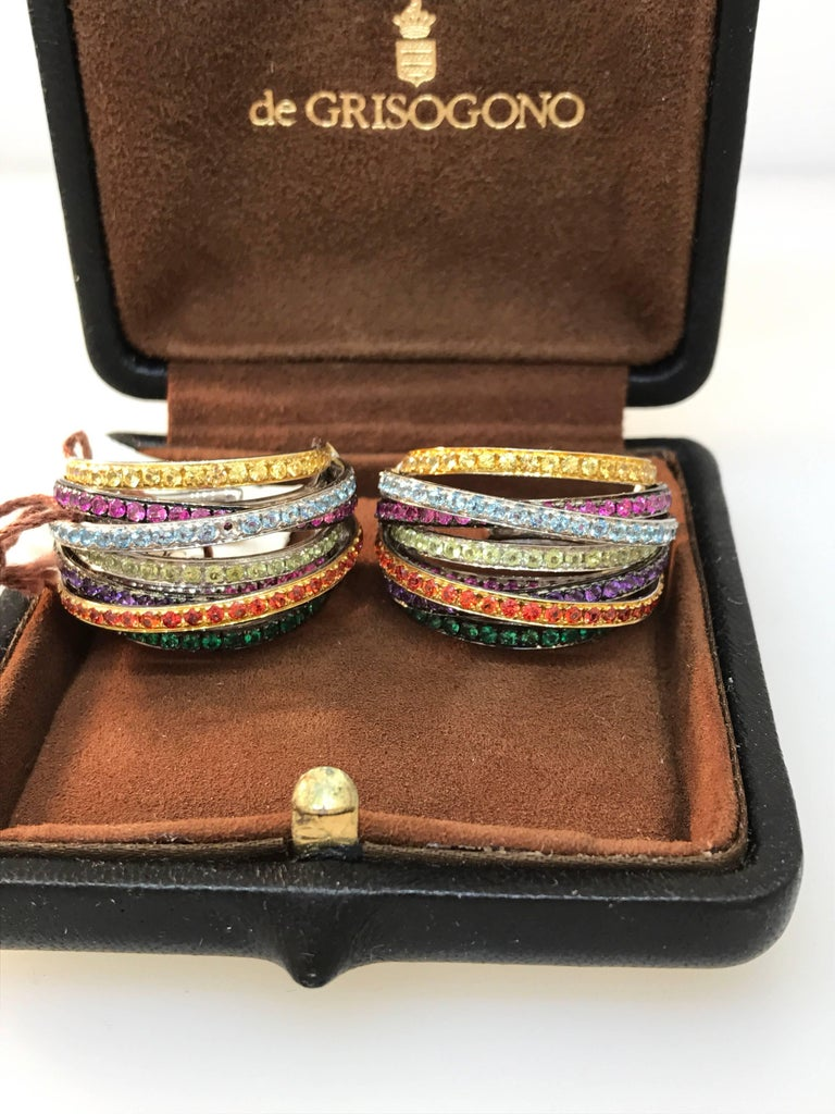 De Grisogono Allegra Earrings  Model Number 14022/08  100% Authentic  New / Old Stock  Comes with a generic earrings box  18 Karat white gold  Earrings set with multiple colored stones  Can fasten as butterfly or just clip-on  Retails for $32,900