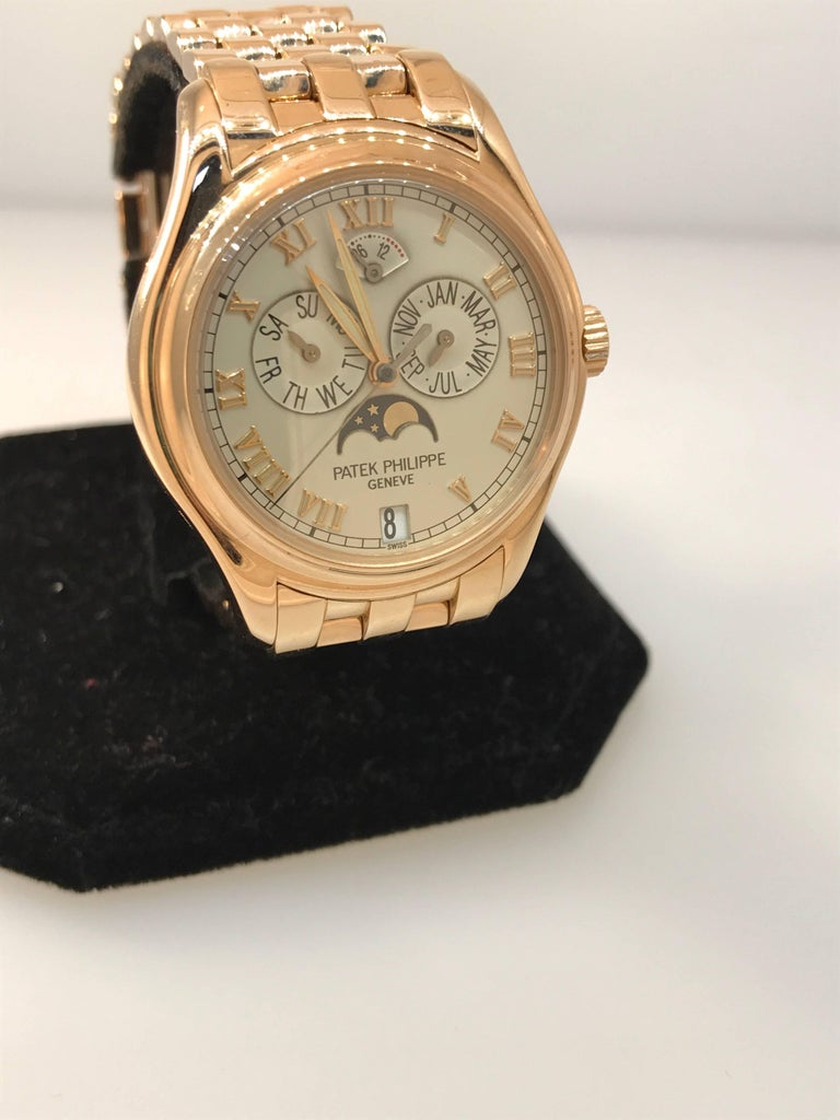 Patek Phillippe Annual Calendar Moonphase Men's watch  Model number 5036/1R  100% Authentic  PRE-OWNED   Comes with Patek Phillipe box, leather pouch and manual (warranty is missing)  18 karat rose gold case and bracelet  Scratch resistant sapphire