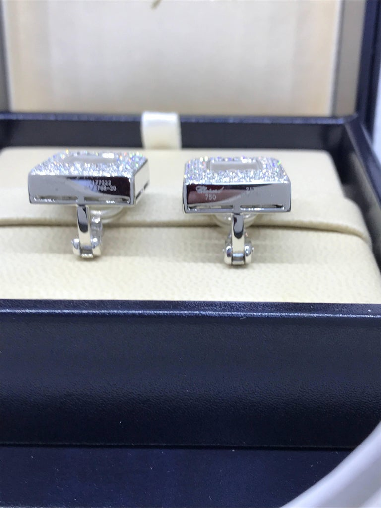 Chopard Happy Diamonds Square Earrings  Model number 84/2768-20  100% Authentic  New / Old Stock  Comes with original Chopard box, certificate of authenticity and warranty and jewels manual  18 Karat White Gold  Clip-On Style  200 Diamonds on the