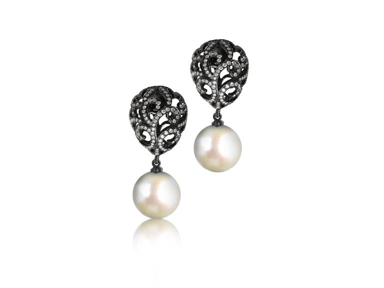 Fei Liu Fine Jewellery's luxurious 18ct gold collection full of drama and elegance.  The Whispering Collection emulates femininity and glamour, with its sculptural yet delicate filigree detail. The lustrous Southsea pearl suspends from the intricate
