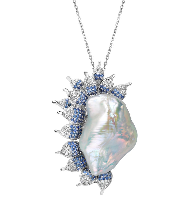 Description: Imperial Wave brooch and pendant with 42.5ct baroque pearl, 0.92ct blue sapphire and 0.5ct white diamonds.  *Note: chain not included.  Inspiration: The Imperial Wave is a versatile two-way wear piece; to be worn as a sophisticated