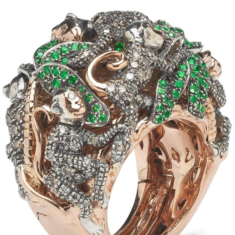 The Monkey Ring-in-a-Ring is a statement ring by Bibi van der Velden, using a technique she developed that allows you to open the bottom of the bigger ring to remove a smaller ring inside. The big ring, depicting playful monkeys and palm trees, is