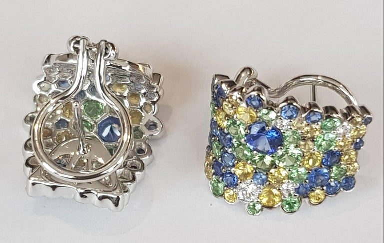 Sapphire, Tsavorite and Diamond Ring 8 diamonds ca 0.26 ct 46 blue sapphires 2.52 ct 42 yellow sapphires 1.75 ct 30 tsavorites 1.67 ct 18 karat white gold comes with studs and clips / either can be removed