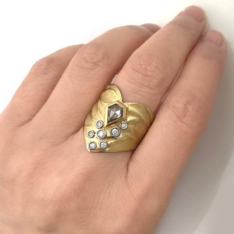 K.Mita's Chevron Heart Ring, which is made from 18 Karat Yellow Gold, features a 0.44 Carat Kite Shape Champagne Diamond accented with 0.165 Carat White Diamonds (total weight) set in 18 Karat Palladium White Gold. Ring Size 6.25 (contact us to