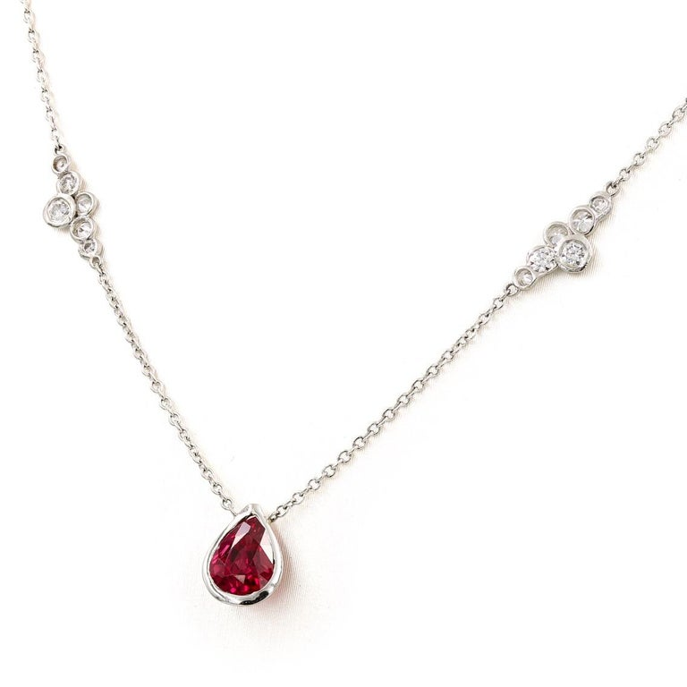 This Lester Lampert original necklace in platinum has a pear shape ruby center = .98ct. and two small pirouette diamond sections with .40ct. t.w. (the diamonds are G-H in color and VS clarity) The ruby stone is from Thailand and has only been heat