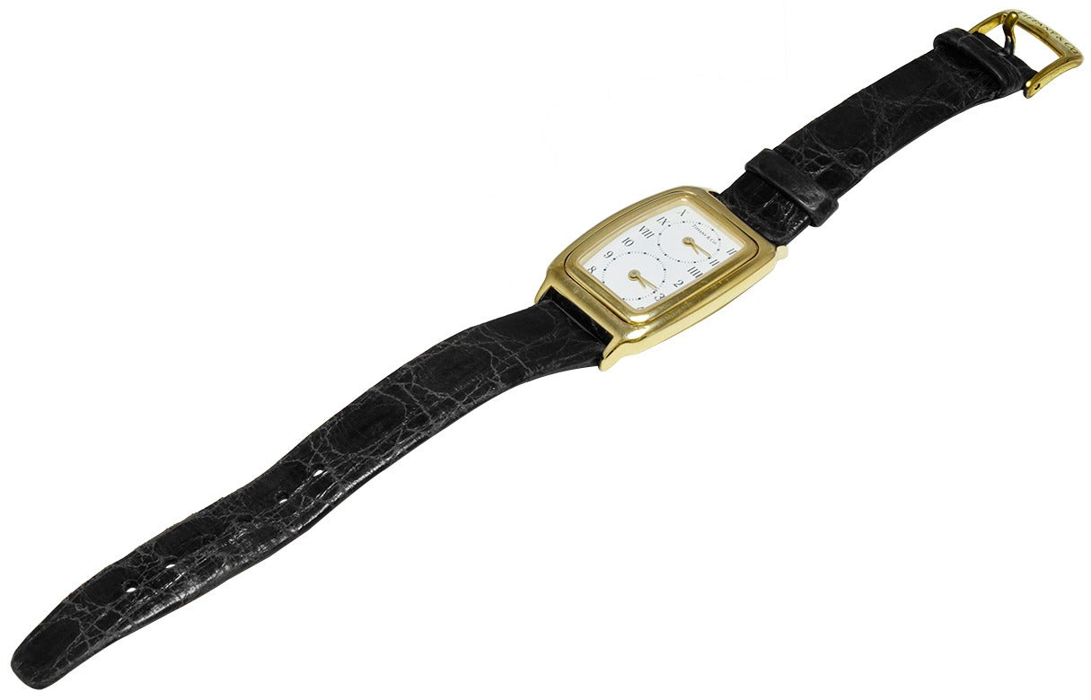 Women's Duel-Time Zone watch, made by Tiffany & Co. 18K gold. A precision quartz movement for each time zone. Roman numerals as well as arabic numbers.  A very attractive, unusual and practical watch.