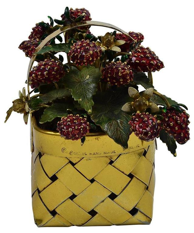 "Beautiful figural basket overflowing with ripe strawberries.  Made and signed by CARTIER.  Hand made sterling silver, with a rich vermeil finish.  Red enamel strawberries, with green leaves and a few white blossoms.  4 1/2"" wide x 3 1/2"" high.  A"