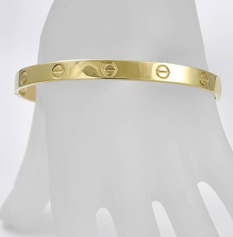 """Classic """"Love Bracelet"""" made and signed by ALDO CIPULLO for CARTIER.  18K yellow gold.   Size 21.  With screwdriver.  In superb condition, with a heavy, substantial gauge of gold.  Alice Kwartler has sold the finest antique gold and"""