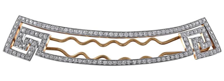 "Dramatic large barrette.  Made and signed by BLACK STARR & FROST.  14K yellow gold; platinum top, encrusted with approximately  9 cts. of brilliant white diamonds, set in a unique geometric pattern.  3 1/2"" x 1/2.""  Made c. 1890. A"