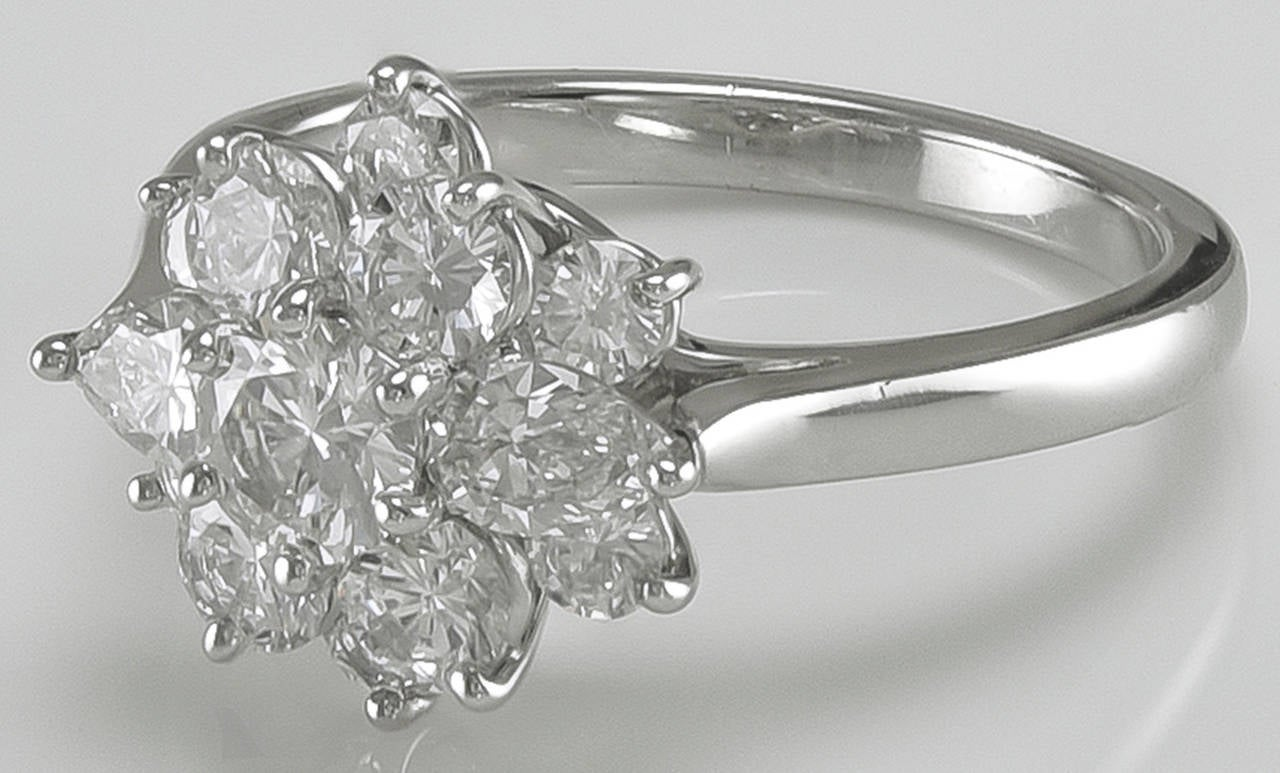 Beautiful, brilliant diamond cluster ring.  Made and signed by Tiffany & Co.   Approximately 1.50 cts. of exceptional round and pear-shaped diamonds set in platinum.  Size 6 and can be easily sized. This is a special ring.  Alice Kwartler has
