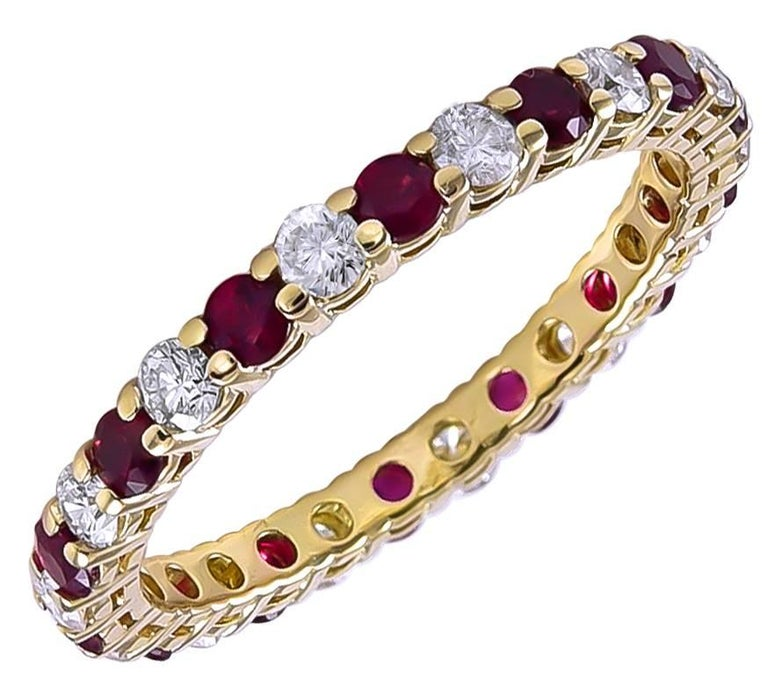 Estate eternity band set with alternating bright faceted rubies and diamonds.  Made and signed by TIFFANY & CO.  18K yellow gold.  Size 5.  A beauty, especially desirable since TIFFANY no longer makes these rings with rubies.  Alice Kwartler has