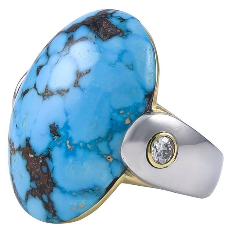 Big and beautiful oval turquoise ring.  The backing is 18K gold.  The band is heavy gauge platinum;  with an 18K bezel-set diamond on each side of the center stone (.50 ct).   The turquoise measures 25mm x 28mm.   A one-of-a-kind, most original