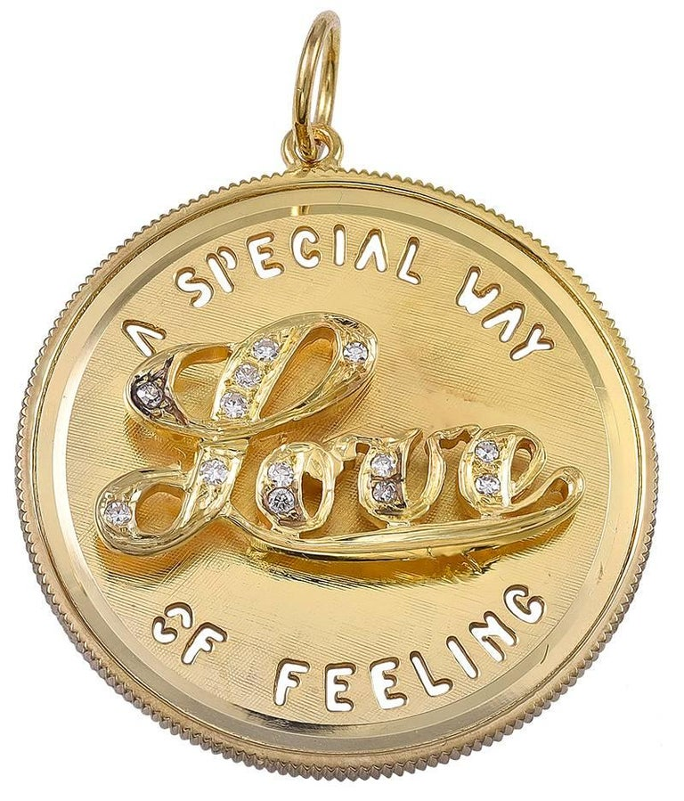 "Large round charm.  Cut-out letters spell out ""A SPECIAL WAY OF FEELING.""  A three-dimensional cartouche in the center spells out ""LOVE"" in brilliant cut diamonds.  1 1/8"" in diameter.  Alice Kwartler has sold the finest"