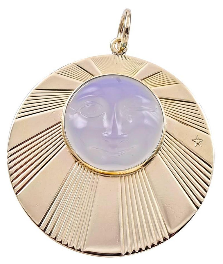 Large round charm/pendant, with radiating line pattern.   Applied is a large moonstone, with a carved