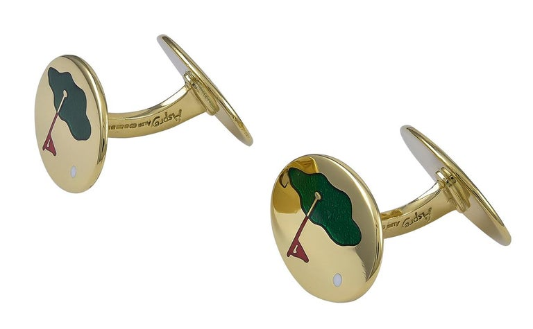 Striking double-sided cufflinks.  Made and signed by ASPREY.  18K yellow gold ovals, depicting a golf course, with a green enamel