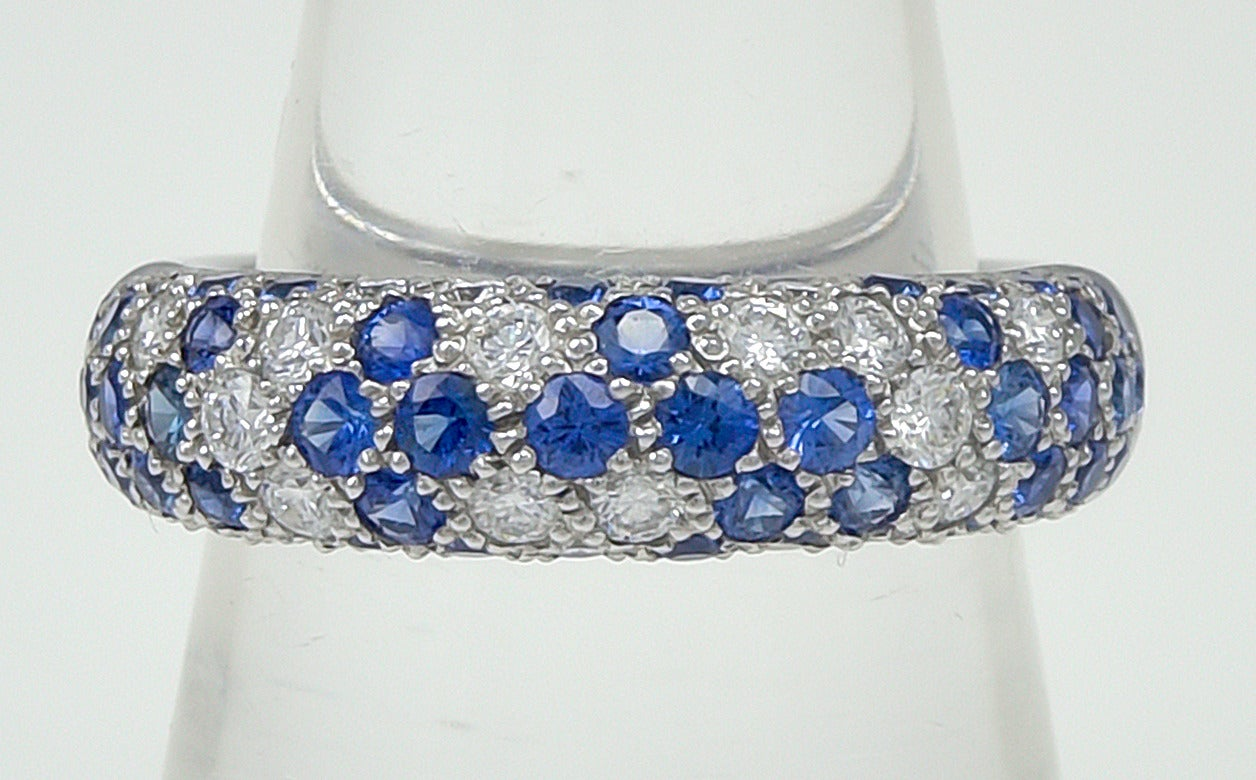 Vibrant diamond and sapphire ring. Made, signed and numbered by Cartier. Set in 18k white gold. .60ct of brilliant diamonds and 1ct of vivid blue sapphires