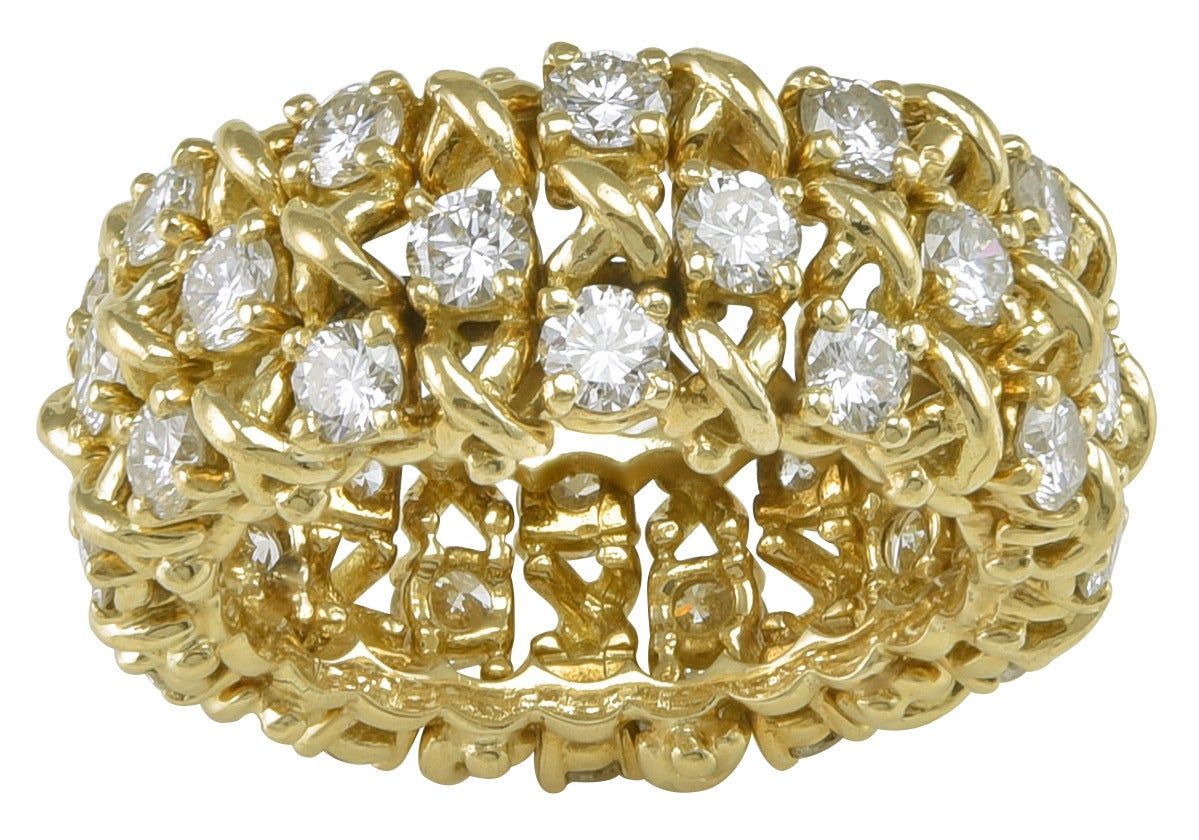 Sparkling wide diamond band.  Made and signed by TIFFANY & CO.  18K yellow gold; three rows of brilliant white diamonds  (approximately 3.25 cts).   Size 5  1/2.  A striking and important ring, no longer made by Tiffany.  Alice Kwartler has sold
