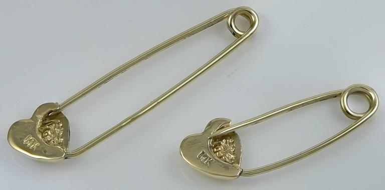 "Two safety pins with figural heart closures. 14K yellow gold. 1-1/2"" long and 1"" long. Adorable.