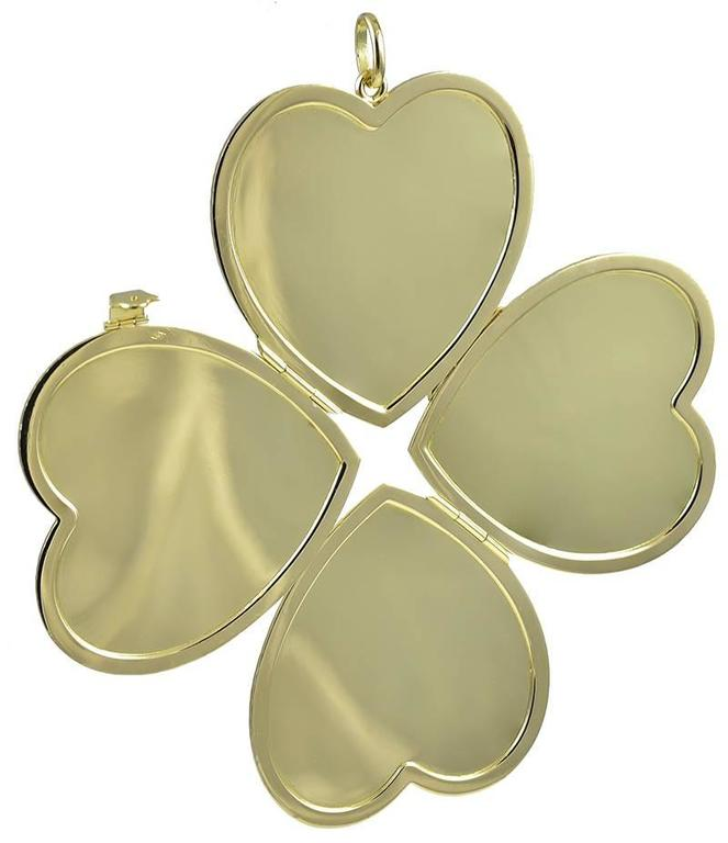 Large Heavy Gold Four-Picture Heart Locket  In Excellent Condition For Sale In New York, NY