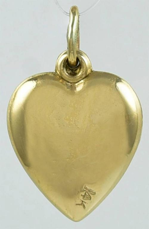 Charming charm.  A figural heart spinner, engraved