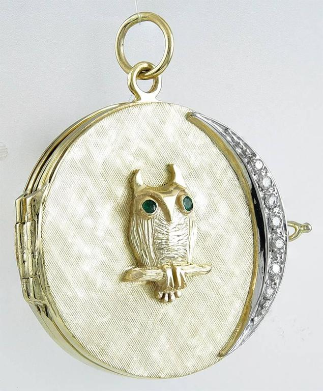 "Superb 14K 4-picture locket,  An applied owl, with faceted emerald eyes, sitting on a branch, looking at a diamond crescent moon.  Textured 14K yellow gold front; shiny gold back; never engraved.  1 1/4"" in diameter.  Whimsical and"