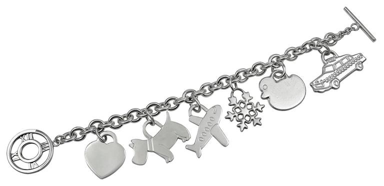 Sterling Silver Charm Bracelet With Six Figural Charms Made And Signed By Tiffany Co