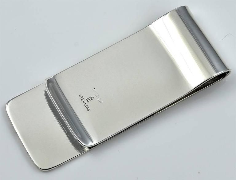 Amusing sterling silver money clip engraved