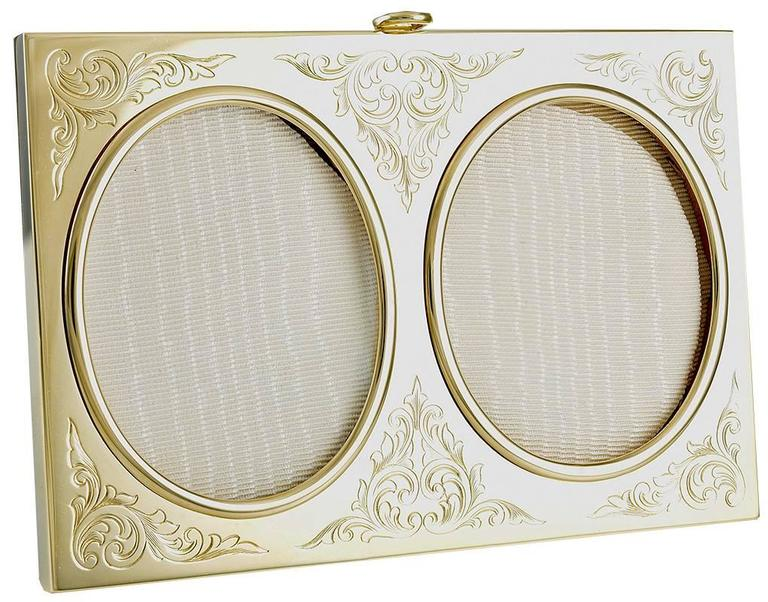 Exquisite picture frame for two photographs.  14K yellow gold with fine hand-engraved leaves around each picture.  Overall size of frame is 4 1/2