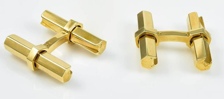 """Classic and elegant beveled """"baton"""" cufflinks.  Made, signed and numbered by CARTIER.  18K yellow gold.  1"""" x 1.""""  Easy to use and in impeccable taste.  Alice Kwartler has sold the finest antique gold and diamond jewelry and"""